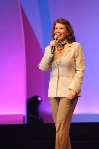 Collette telling a story from the stage at USANA's International Convention